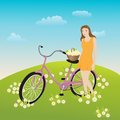 Girl standing near bicycle on a daisy meadow Royalty Free Stock Photos