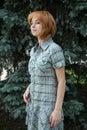 Girl standing near fir tree Stock Images