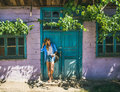 Girl standing near purple wall in Turkish village in summer Royalty Free Stock Photo