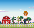 A girl standing near the red barnhouse inside the fence illustration of Stock Images