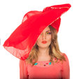 Girl standing with a red hat on his hea white background head Royalty Free Stock Images