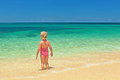 Girl standing on the sand beach Royalty Free Stock Photo