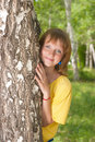 The girl stands near to a birch Stock Images