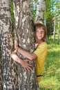 The girl stands near to a birch Royalty Free Stock Image