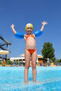 Girl stands on skirting in pool near hotel Stock Photography