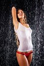 Girl, stands under the water jets Royalty Free Stock Photography