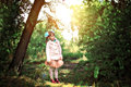 A girl stands in the woods Royalty Free Stock Photo