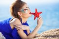 Girl with starfish in hand Royalty Free Stock Photography