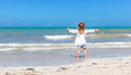 Girl staring at the ocean one little on a yucatan beach Royalty Free Stock Photo