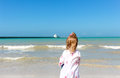 Girl staring at the ocean one little on a yucatan beach Stock Image