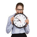 Girl in a state of stress bites the clock big Stock Photography