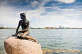 Girl statue sitting on rock Stock Photography