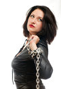 Girl and a steel chain seductive young holding on white background Royalty Free Stock Photo