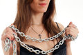 Girl and a steel chain seductive young holding on white background Stock Photos