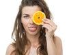 Girl sticking out tongue and holding orange slice Stock Image