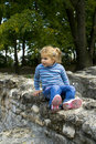 Girl on stone wall Stock Photo