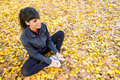 Girl stretching legs in autumn Royalty Free Stock Images