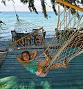 Girl in string hammock Royalty Free Stock Photo