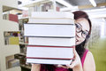 Girl student behind books Royalty Free Stock Images