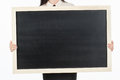Girl student, businesswoman in casual clothes holding a black chalk board with empty blank space for your text. on a white backg Royalty Free Stock Photo