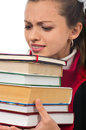 Girl student carrying heavy books Stock Image
