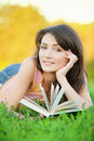 Girl-student read a textbook. Royalty Free Stock Photography