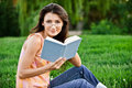 Girl-student reads textbook. Stock Photo