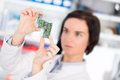 Girl student studying electronic device with microprocessor a Royalty Free Stock Photos