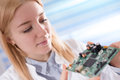 Girl student studying electronic device with microprocessor a Royalty Free Stock Photography