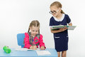 Girl student teacher dictating dictation two girls play school and Royalty Free Stock Images
