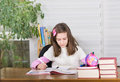 Girl studying young with bow in hair in her room Royalty Free Stock Image