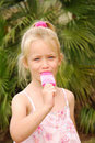 Girl sucking ice lolly Royalty Free Stock Images