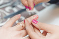 The girl suffered a cut finger on the manicure. Royalty Free Stock Photo