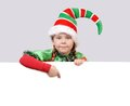 Girl in suit of christmas elf with the banner little white board Royalty Free Stock Photography