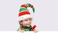 Girl in suit of christmas elf with the banner white Royalty Free Stock Photo