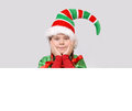 Girl in suit of christmas elf with the banner white Stock Photos