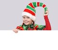 Girl in suit of christmas elf with the banner white board Stock Images