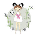 Girl in a suit of panda Royalty Free Stock Photo