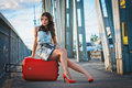 Girl with a suitcase on the bridge Royalty Free Stock Images