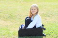 Girl in suitcase little blond black pants and white t shirt sitting black chech baggage Royalty Free Stock Photography