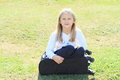 Girl in suitcase little blond black pants and white t shirt sitting black chech baggage Royalty Free Stock Photos