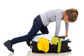Girl suitcase zip young kneeing on trying to it up Royalty Free Stock Image