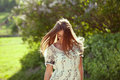Girl in a summer dress with long hair goes Royalty Free Stock Images