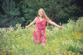 Girl in summer field Royalty Free Stock Photo