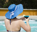 Girl in summer hat in jacuzzi hot tub relaxing Stock Images
