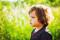 Girl in summer light portrait green grass garden Stock Photos