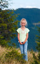 Girl in summer mountain Stock Images