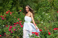 Girl in summer park beautiful white dress enjoying green Royalty Free Stock Images