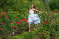 Girl in summer park beautiful white dress enjoying green Stock Image