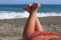 Girl sunbathe on the beach Stock Image